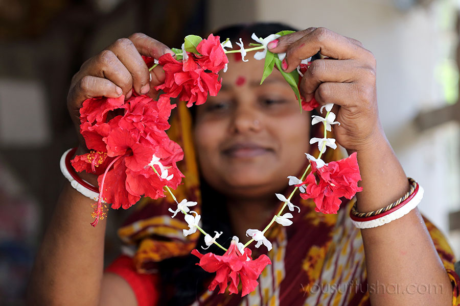 The woman making flower ornament in Khulna, Bangladesh. Photo by M. Yousuf Tushar. April 19, 2014