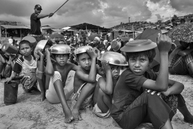 Hundreds Rohingya childrens are waiting for food near Thankkhali Refugees camp.