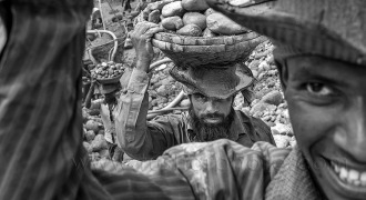 Stone labor carry stone on their overhead