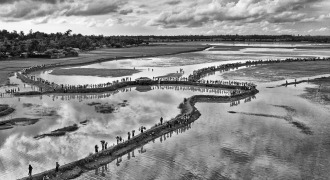 A Birdseye view of hundreds Rohingya people are crossing no man's land to enter Bangladesh at Bangladesh and Myanmar boarder area, Cox's Bazar, Bangladesh. In 2017 More than 750,000 Rohingya peoples crossed the border to come Bangladesh after the Burmese army started an operation against the Rohingyas, by burning and destroying their home in the Rakhine state of Myanmar.
