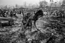 The children search for belongs in ashes burned in the fire. An estimated 45,000 people have been displaced after a huge fire tore through a Rohingya refugee camp in Bangladesh. At least 15 people have been killed and hundreds are still missing after the blaze at the Balukhali camp near the southeastern town of Cox's Bazar late on Monday.