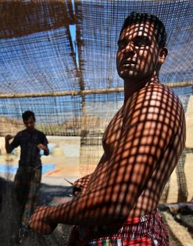 Fishermen repair net