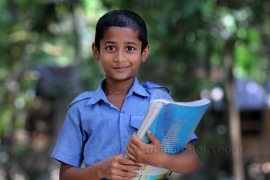 Smiling face of Shakib son of successful farmer Abu Hanif is going to school in Khulna, Bangladesh. Photo by M. Yousuf Tushar. April 17, 2014