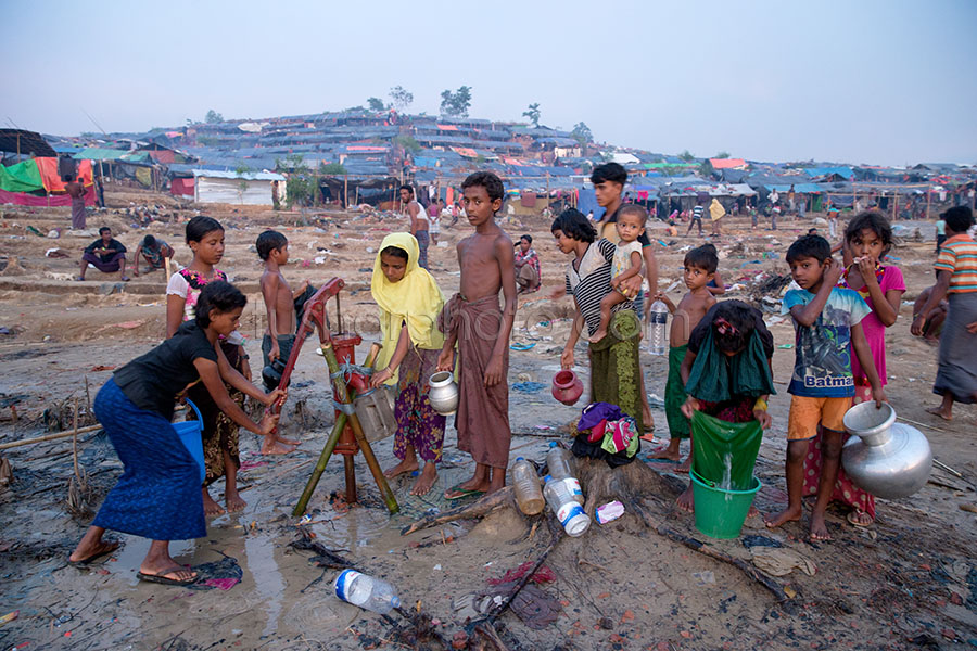 PALONGKHALI, UKHYA, COX'S BAZAR, BANGLADESH- SEPTEMBER 26, 2017: Rohinga people are Collecting water at Palongkhali, Cox's bazar.Thousands of Rohingyas still crossing the border between Myanmar and Bangladesh after the Burmese army started an operation against the Rohingyas, by burning and destroying their home in the Rakhine state of Myanmar, as now more than 410,000 Rohingyas crossed the border and the United Nations expect the number rises to 1 million by the end of the year.