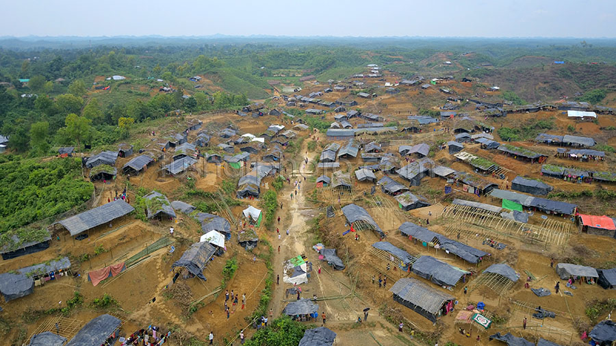 PALONGKHALI, UKHYA, COX'S BAZAR, BANGLADESH- SEPTEMBER 06, 2017: Aerial view of Newly built temporary camp for Rohingya people at Palongkhali, Cox's bazar.Thousands of Rohingyas still crossing the border between Myanmar and Bangladesh after the Burmese army started an operation against the Rohingyas, by burning and destroying their home in the Rakhine state of Myanmar, as now more than 410,000 Rohingyas crossed the border and the United Nations expect the number rises to 1 million by the end of the year.