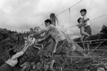 A Rohingya family crossing Barbed wires to enter Bangladesh. Thousands of Rohingyas crossing the border between Myanmar and Bangladesh after the Burmese army started an operation against the Rohingyas, by burning and destroying their home in the Rakhine state of Myanmar. According to UNHCR, more than 723,000 refugees have fled to Bangladesh from Myanmar.